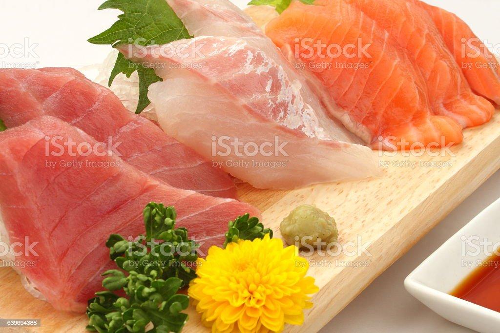 Mixed Raw Fish Sashimi Platter on Wooden Plate , Japanese food stock photo
