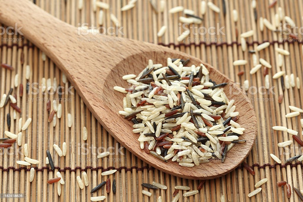 Mixed rice in a wooden spoon royalty-free stock photo