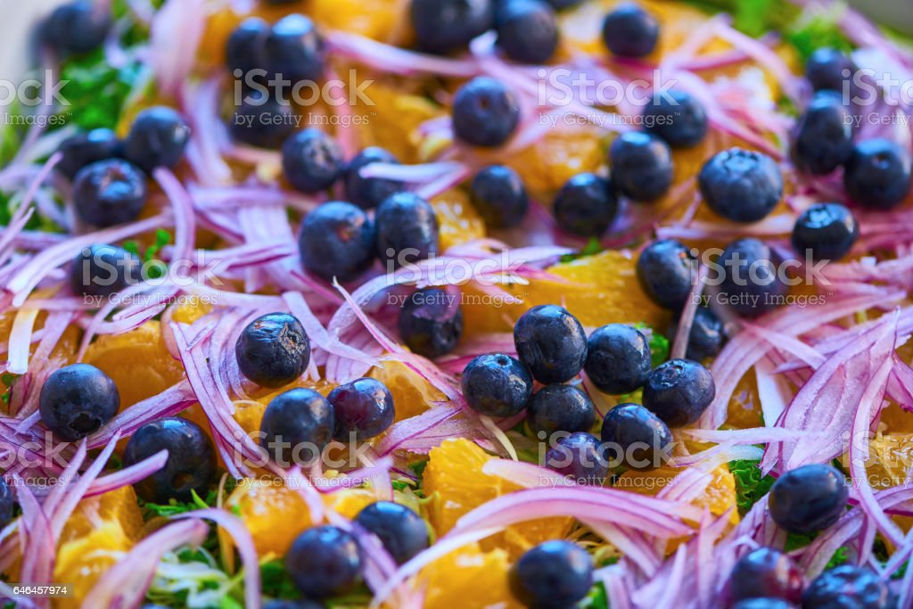 Mixed salad in a white bowl stock photo