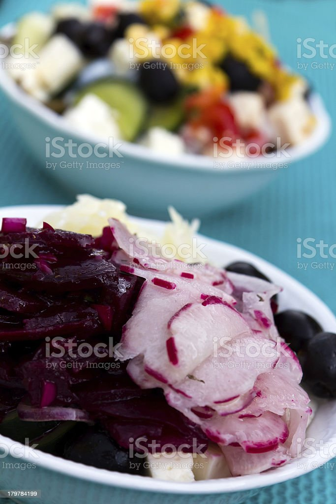 Mixed Salad with cabbage, radish, black olives royalty-free stock photo