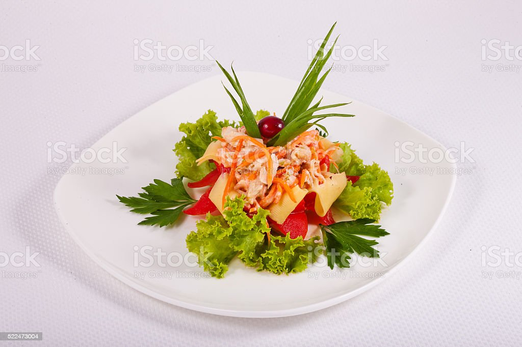 Mixed salad with greens, tomatoes, carrots, pasta in white plate stock photo