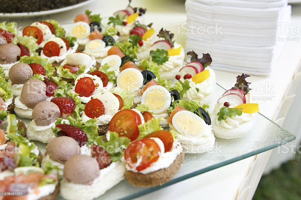 Mixed savoury mini canapes on a plate stock photo