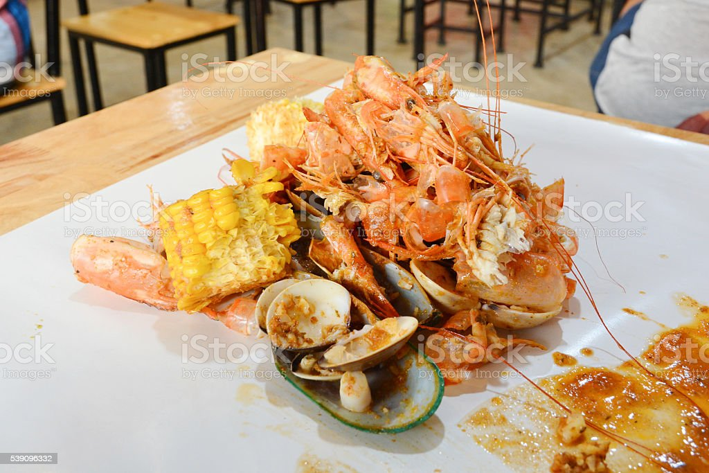 Mixed seafood and corn on the table. stock photo