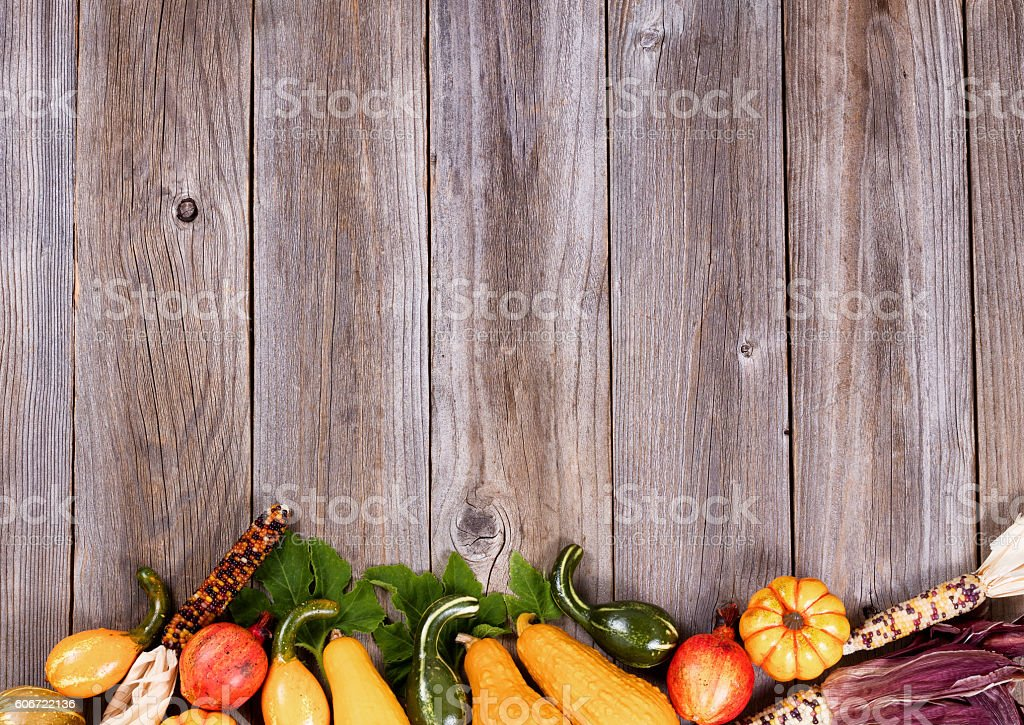 Mixed seasonal autumn vegetables on rustic wooden boards stock photo