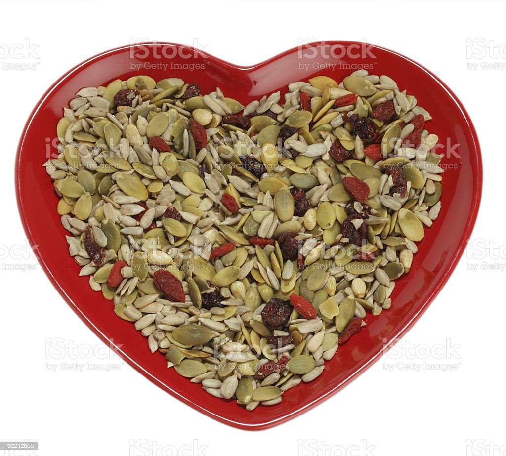 mixed seeds cereal for healthy breakfast or snacking stock photo