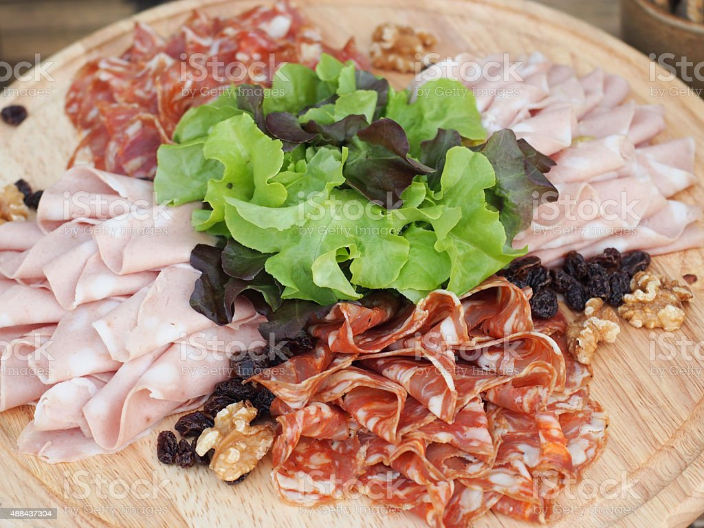 Mixed Sliced Meat on the wooden Board stock photo