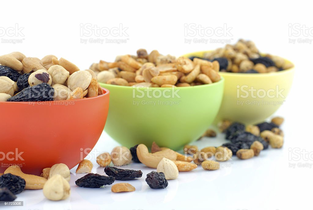 Mixed snack in colorful bowls royalty-free stock photo