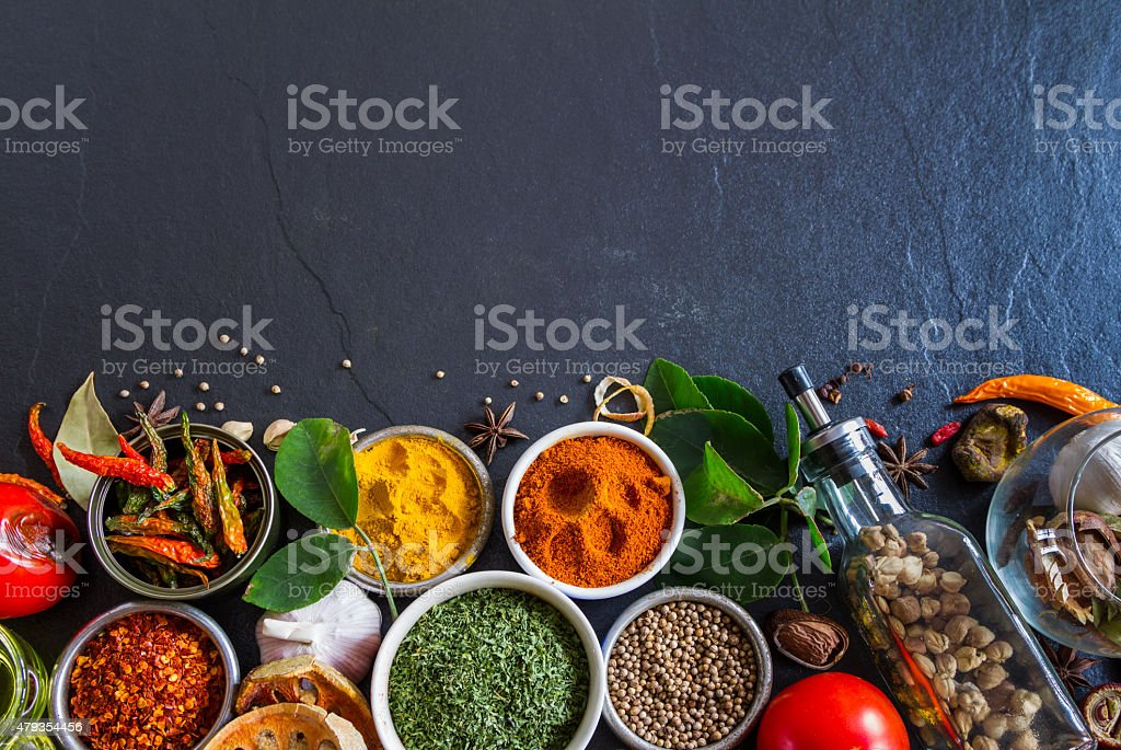 Mixed spices and herbs on background. stock photo