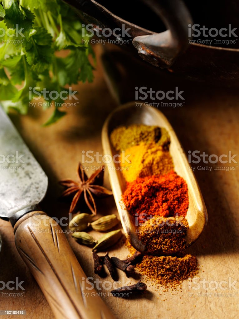 Mixed Spices with Old Cooking Utensils royalty-free stock photo