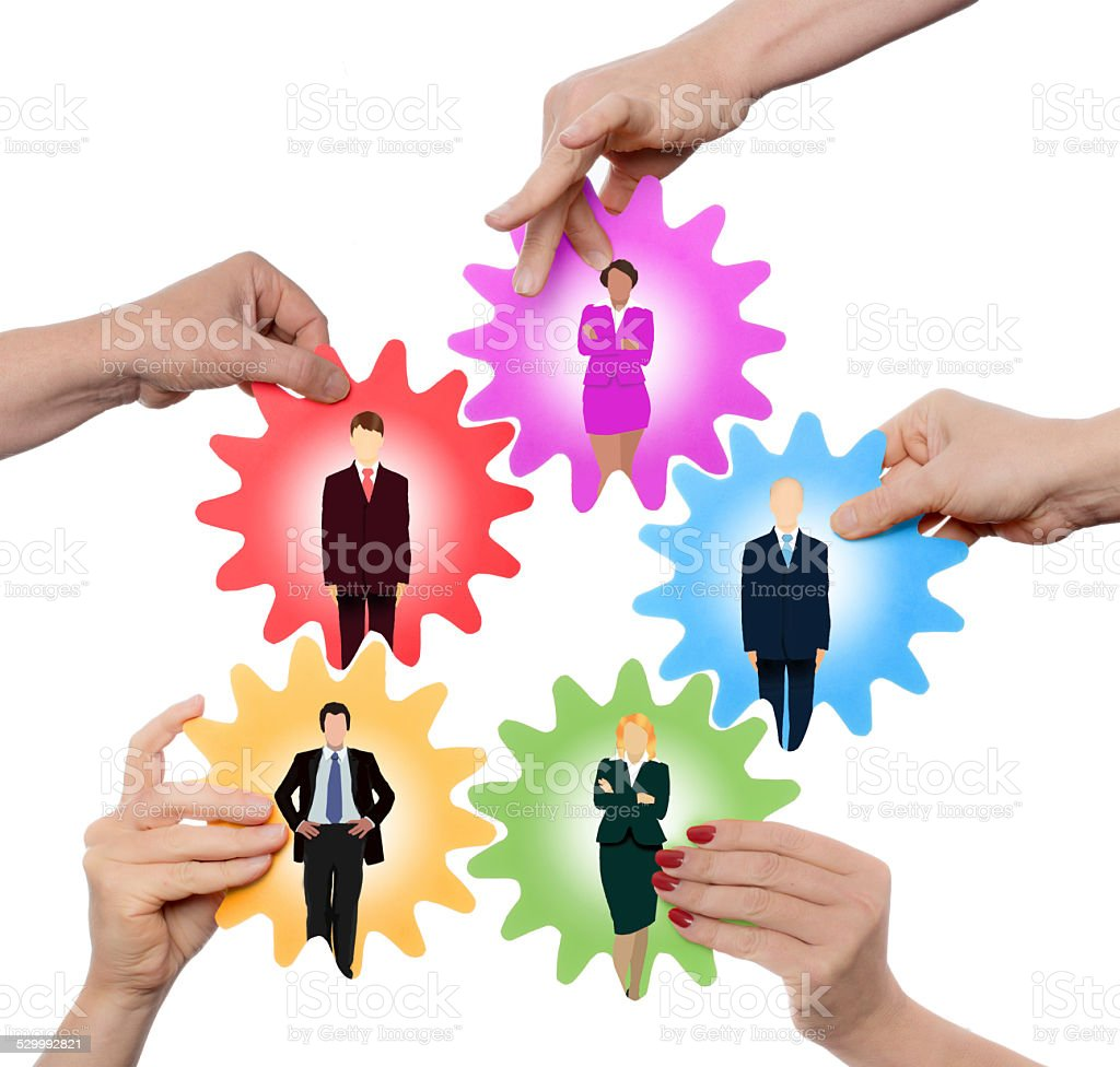 mixed team working together (with team pictures) stock photo