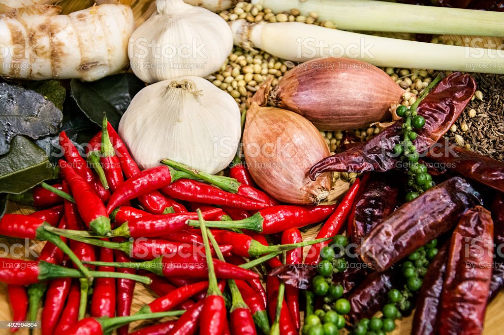 Mixed various spices on wooden plate (shallow DOF) stock photo
