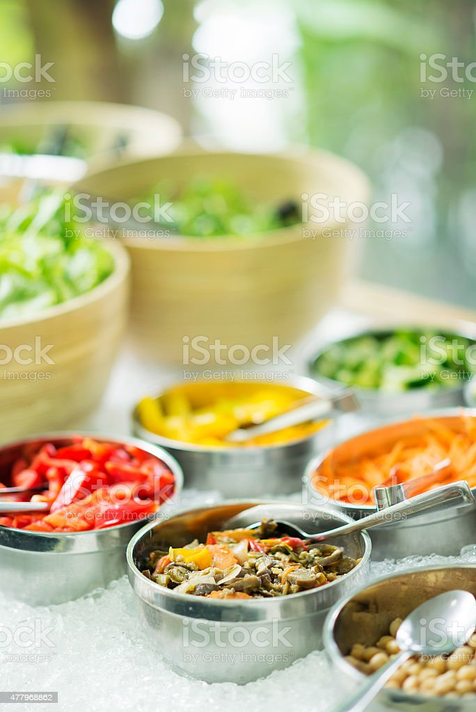 mixed vegetables in salad bar display stock photo