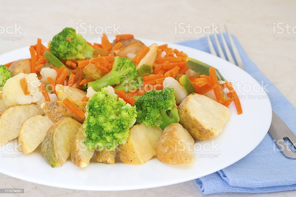 Mixed vegetables on a plate with fork royalty-free stock photo