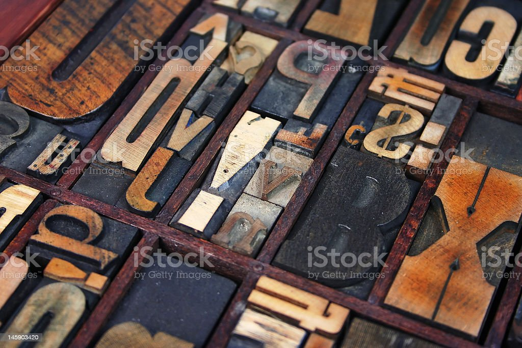Mixed wooden type blocks in a tray stock photo
