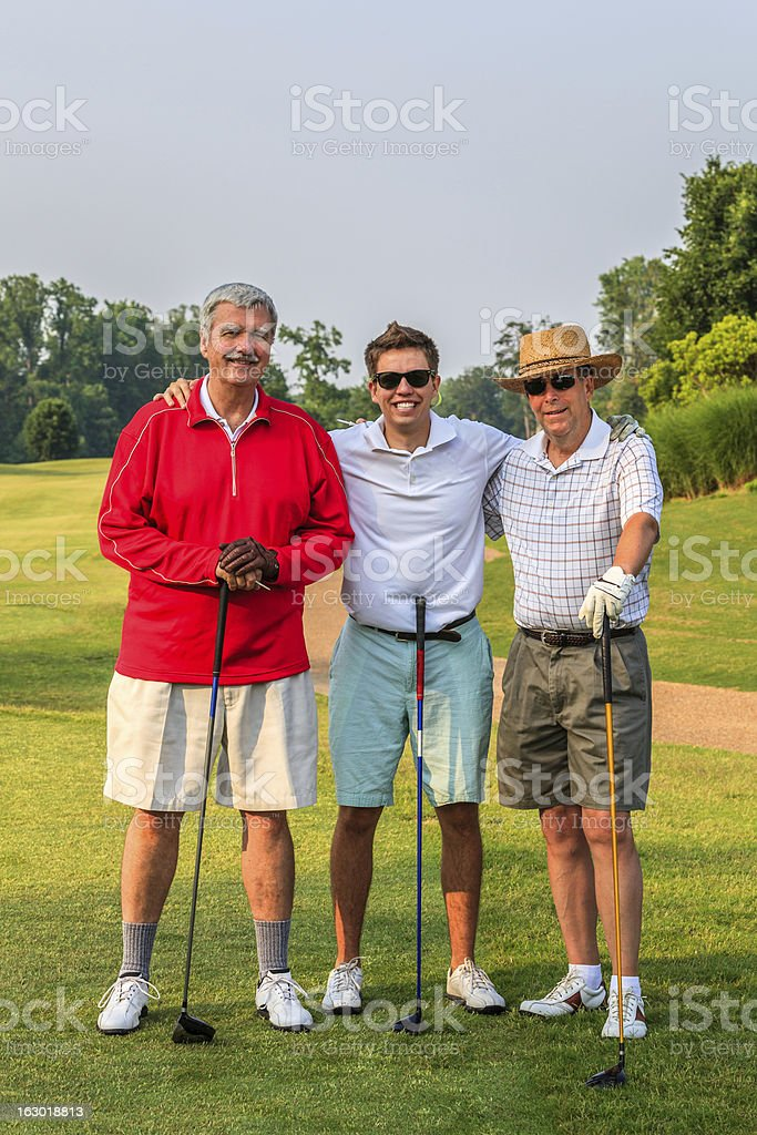 MIxed-Age Men's Golf Threesome royalty-free stock photo