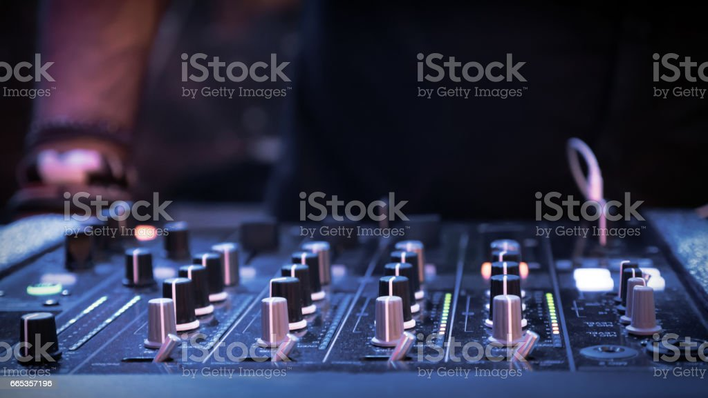 DJ mixer at night party in club stock photo