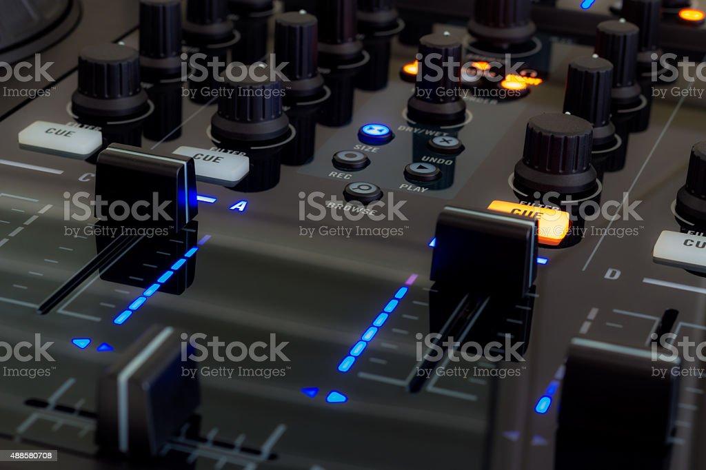 DJ mixer in a club, close up. stock photo