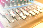 Mixer in recording room. Making light soft