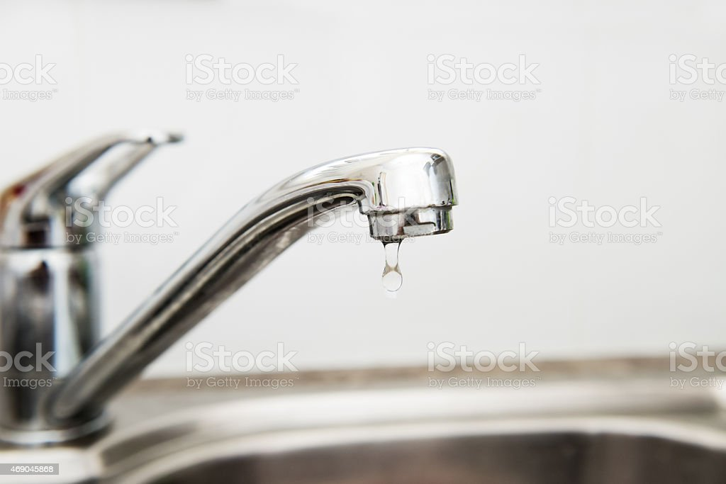 Mixer tap Faucet on the kitchen sink stock photo