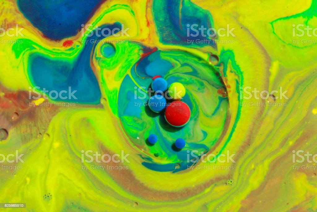Mixing abstract colors in milk with green with blue colors stock photo