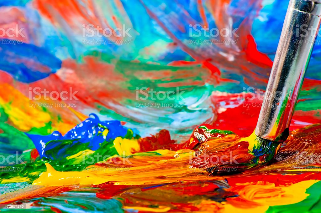mixing acrylic paints on canvas closeup stock photo