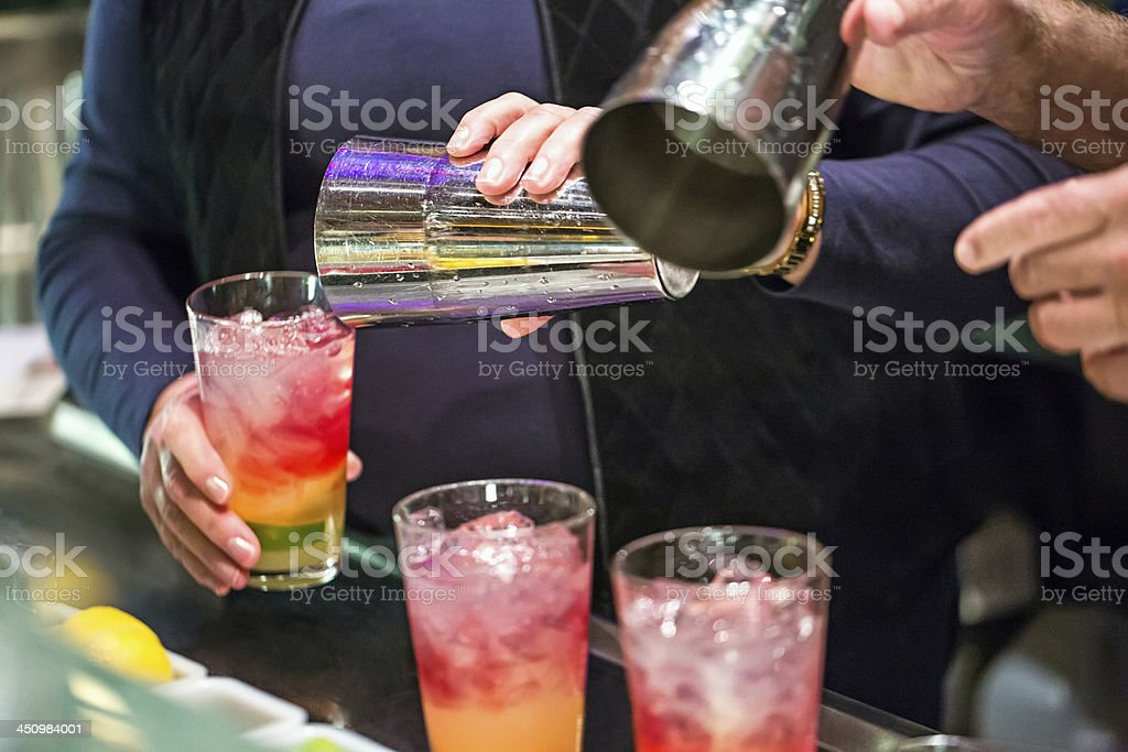 Mixing alcoholic drinks for a holiday party New year's Eve royalty-free stock photo