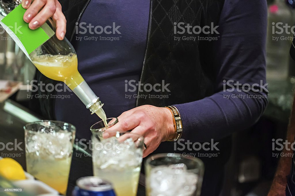 Mixing alcoholic drinks for a holiday party royalty-free stock photo
