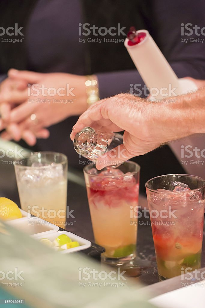 Mixing alcoholic drinks for Christmas and New Year's Eve royalty-free stock photo