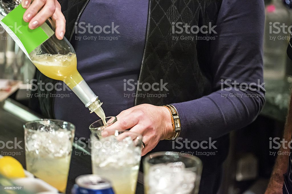 Mixing an alcoholic beverage New year's Eve royalty-free stock photo