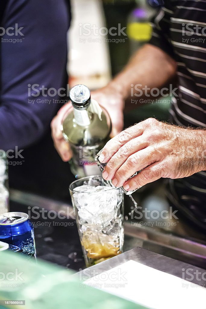 Mixing an alcoholic drink on New year's Eve royalty-free stock photo
