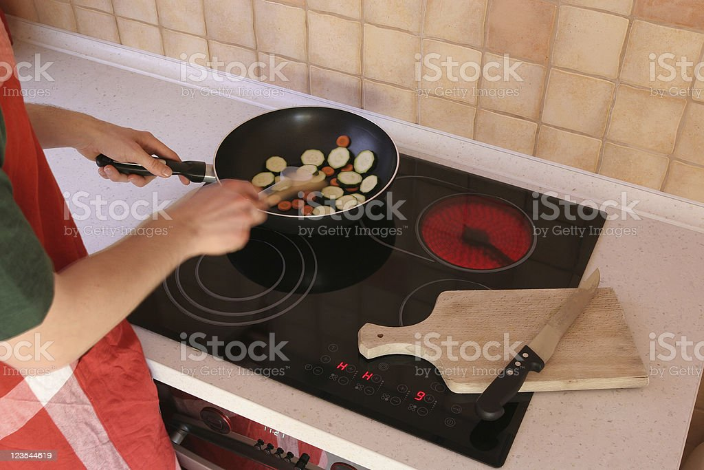 Mixing and cooking food stock photo