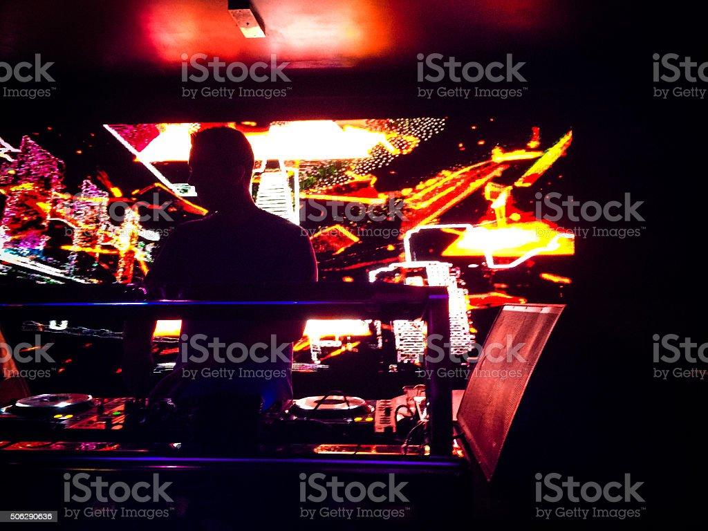 DJ mixing beats in nightclub stock photo