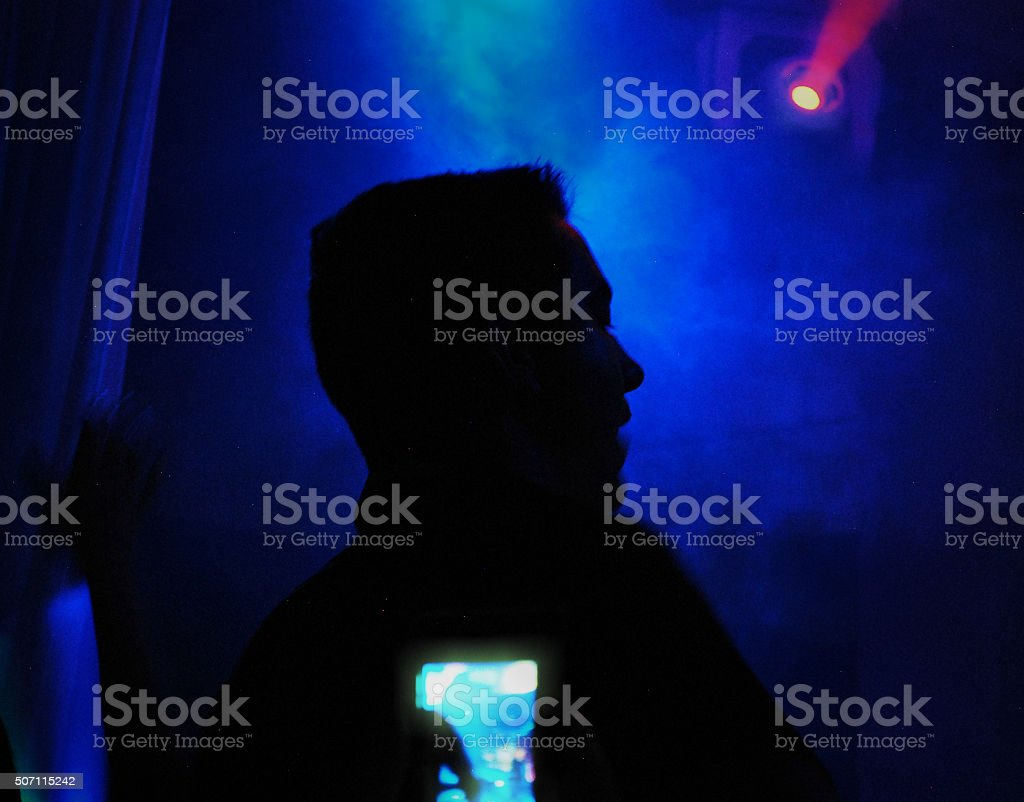 DJ mixing beats in nightclub stock photo