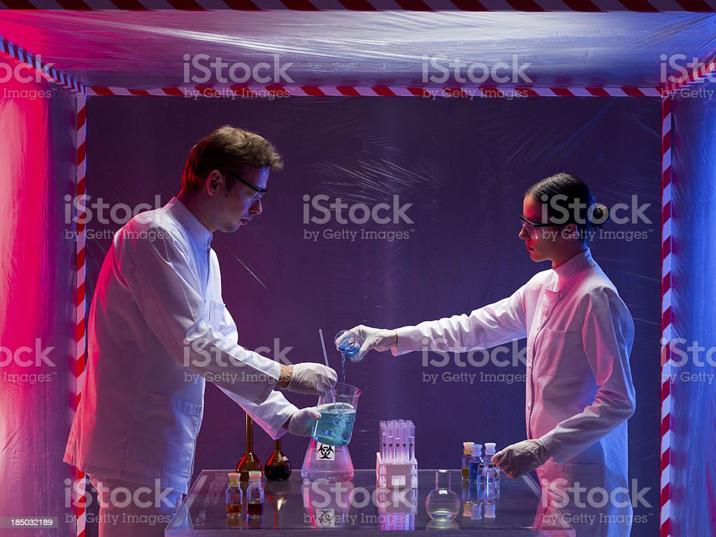 mixing chemicals in a containment tent stock photo