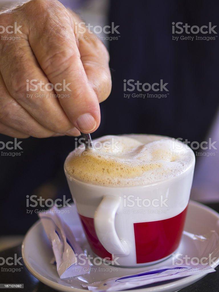 Mixing coffee stock photo