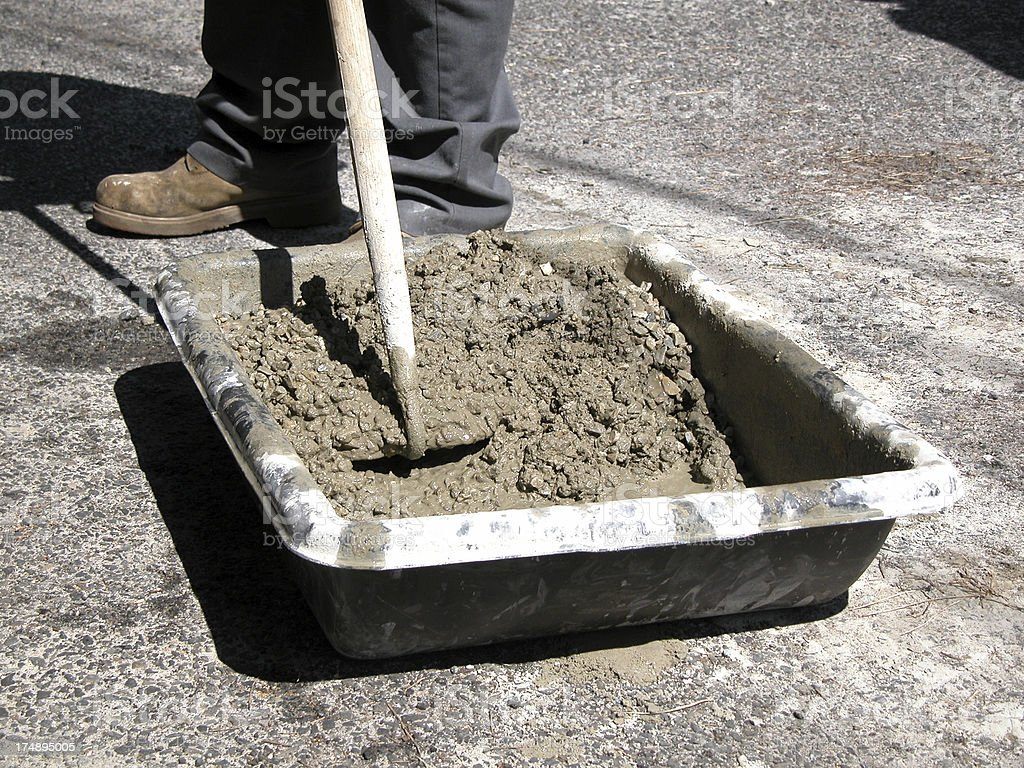 Mixing Concrete Cement by Hand with Hoe, in Plastic Tub royalty-free stock photo