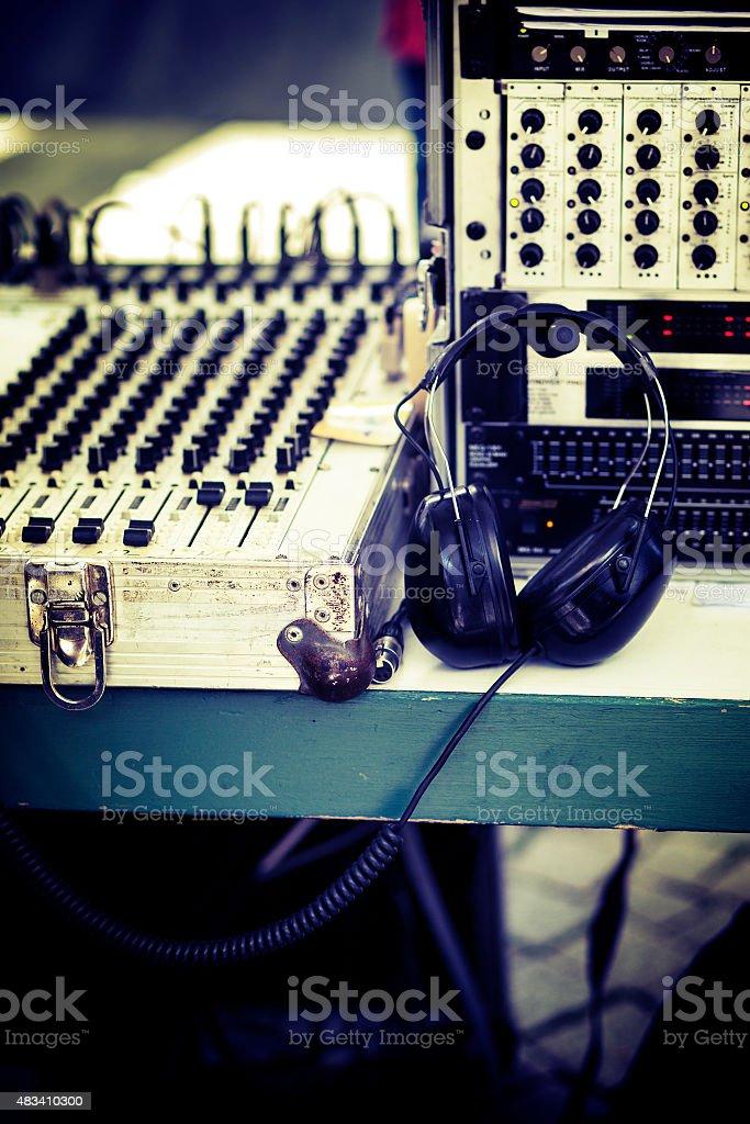 Mixing desk and headphones, selective focus stock photo