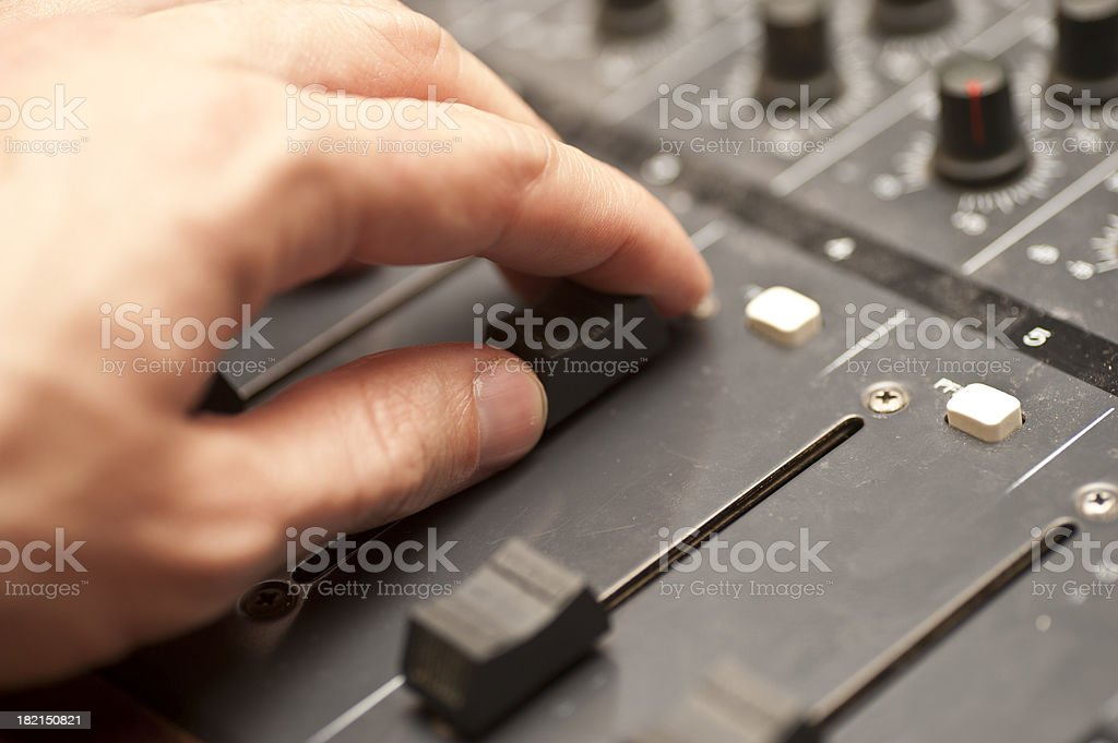 mixing desk with hand stock photo