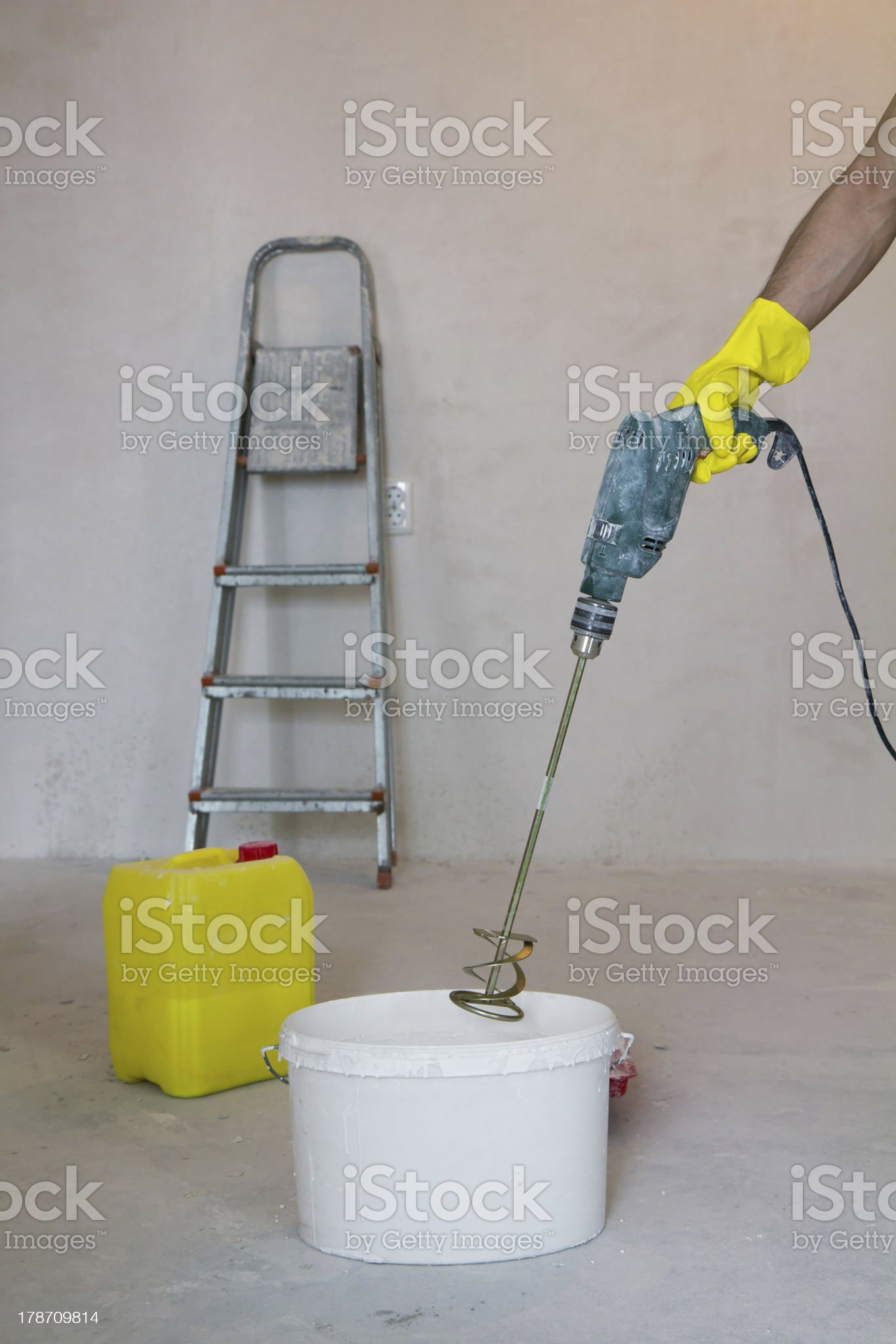 mixing glue with a power drill royalty-free stock photo