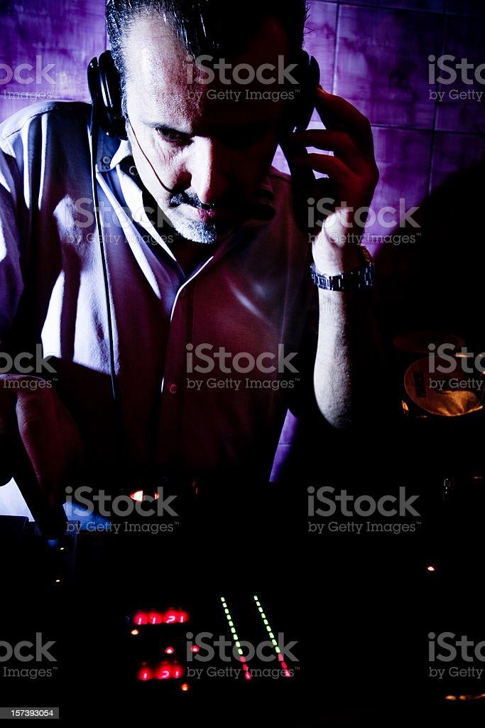 DJ mixing in disco club royalty-free stock photo