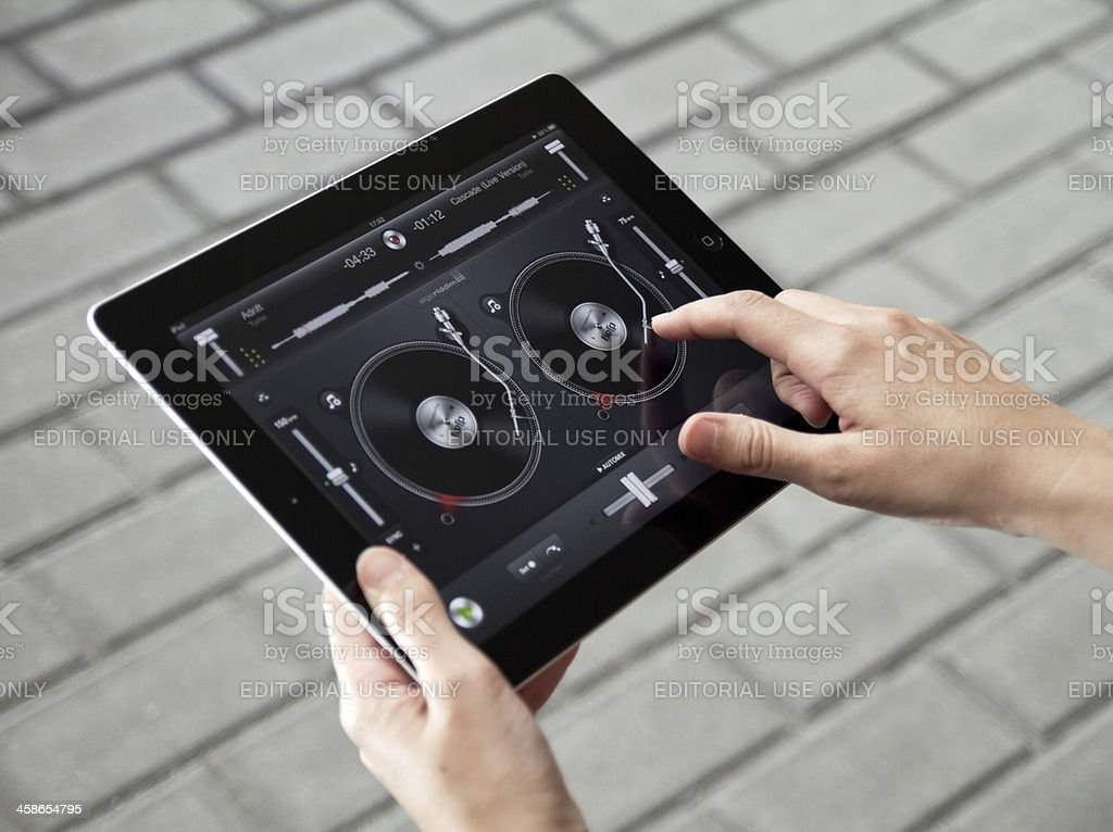 Mixing music on Apple Ipad2 stock photo