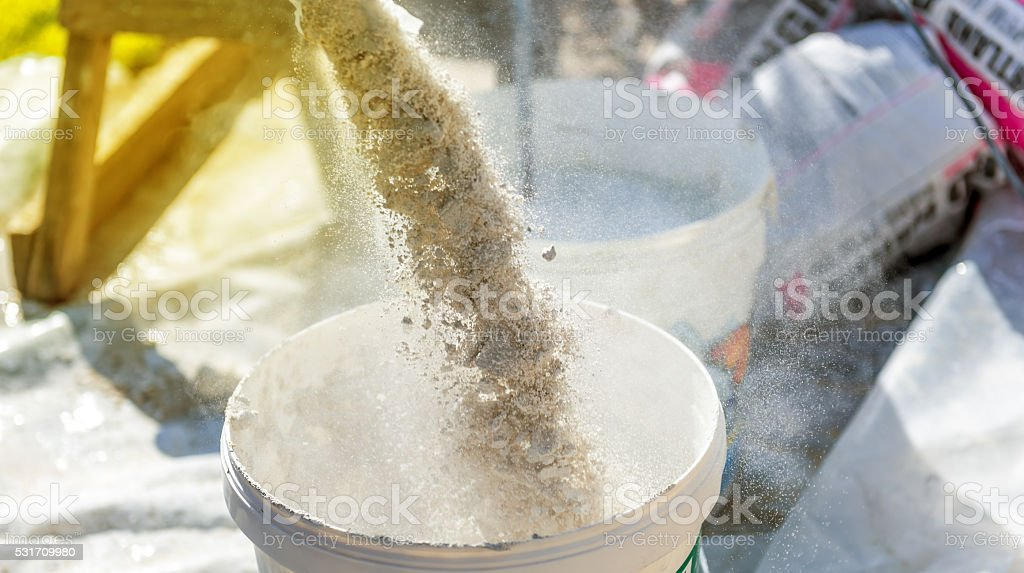 Mixing of a plaster stock photo