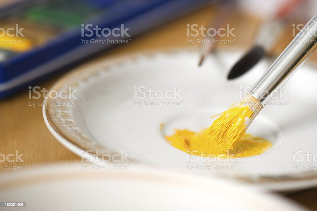 Mixing paints on a plate royalty-free stock photo