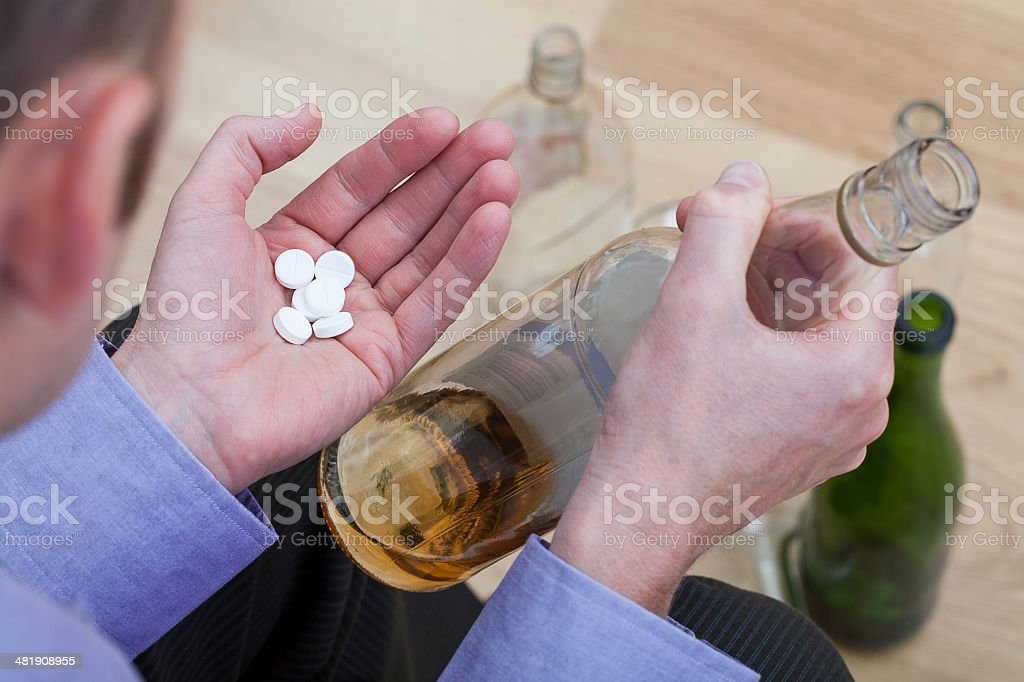 Mixing pills with alcohol royalty-free stock photo