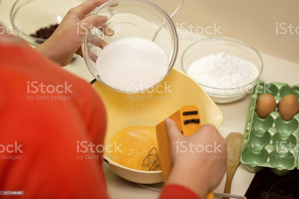 mixing raw eggs in bowl royalty-free stock photo