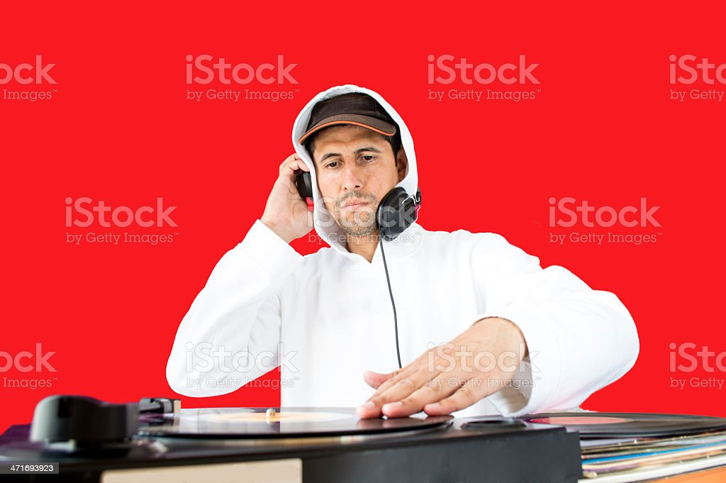 DJ mixing red background stock photo
