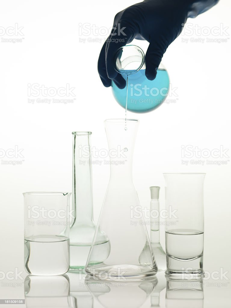 mixing substances in the lab royalty-free stock photo