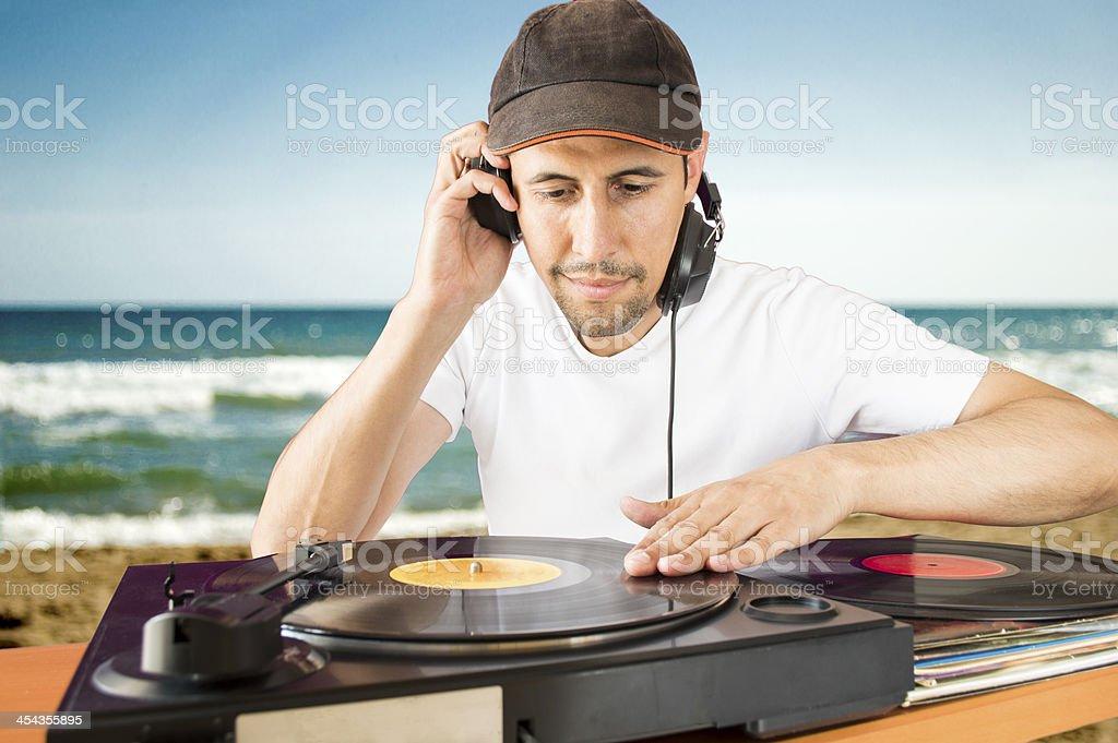 DJ mixing vinyl record on a  turntable stock photo
