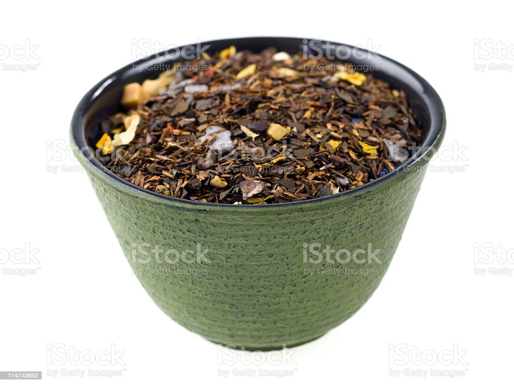mixture of dried tea leaves in a bowl stock photo