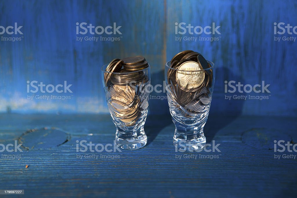 Mixture of money from different nations in a vodka glass royalty-free stock photo